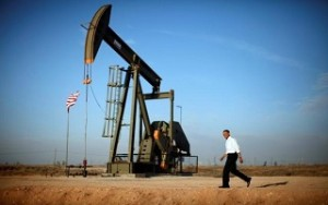 U.S. President Barack Obama walks past a pumpjack in Maljamar